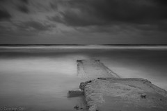 Breaking Storm (GRO Photography) Tags: ocean longexposure sea bw pier horizon stormy abaondoned