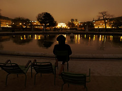 Tuileries looking East (watcher330) Tags: paris night person pond louvre tuileries seated
