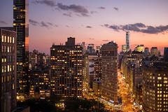 New York's Flatiron Building at Sunset (BrianEden) Tags: city nyc pink sunset sky ny newyork skyline cityscape fuji purple dusk manhattan district worldtradecenter broadway magenta 5thavenue midtown fujifilm fifthavenue flatironbuilding goldenhour xt1 brianedenphotography