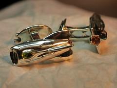 Space-Age Jet-Pack Rocket-Ship Cufflinks - 2 (the justified sinner) Tags: leica macro silver jewelry jewellery mandarin 28 rocketship 45mm gem olivine jetpack garnet spaceage peridot gemstone cufflink elmarit gx7 justifiedsinner silverpanasonic innessthomson