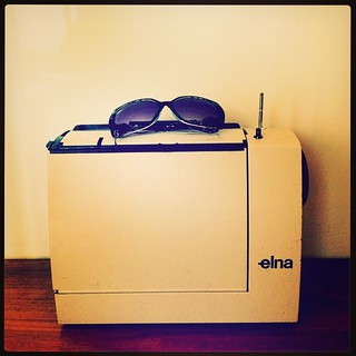 365/337 • this my new (to me) little Elna Lotus sewing machine. Sunglasses are for scale - it's itty bitty! And hopefully perfect for the #liveaboard life... • #2014_ig_337 #elna #lotus #sewing #sewingmachine #small #reallysmall