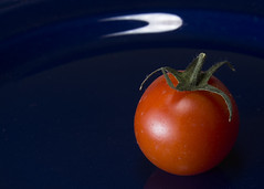 Red sphere (haqiqimeraat) Tags: cherry tomato red nikon stilllife tabletop vegetation vegetables 2485 macro magnify composition flash flashphotography