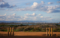 Don't fence me in (angelsgermain) Tags: sky plants mountains water clouds fence river flamingos delta catalonia wetlands catalunya waterfowl ebre deltadelebre parcnaturaldeldeltadelebre