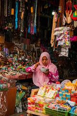 eating lunch (Sam Scholes) Tags: market bedugul candid travel store keeper portrit shop vacation indonesia shopping bali shopstore storekeeper baturiti id