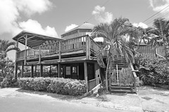 Red Bar (G Reeves) Tags: nikon nikond5100 garyreeves outside landscapes town sand tropical saintlucia westindies caribbean rodneybay holiday sunshine bay clouds palm palmtree blackandwhite bw bar shack decay