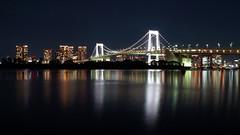 Raindow Bridge, Tokyo (gabrielafundora) Tags: night peaceful cityscape longexposure tokyo city ocean calm shore harbor beach sky japan travel bridge lights blue water sea buildings reflections light asia world amazing dark