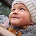 Smiling harness baby thumbnail