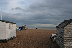 Lonely seaside view (sven_ali) Tags: sea england beach water clouds person boat kent seaside fishing cloudy pebbles huts deal bleak lonely peaople