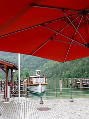 Boat and Umbrella (haidarism (Ahmed Alhaidari)) Tags: trip lake tourism rain germany boat tourist  eurpoe