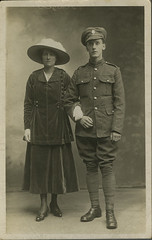 TWCMS.1997.3551 (Tyne & Wear Archives & Museums) Tags: firstworldwar ww1 worlife socialhistory whiteoutline blackandwhitephotograph digitalimage archives documentation worfacesregionalfacesofthefirstworldwar studio wall youngcouple fulllengthstudioportrait woman man darkvelvetskirt civilian soldier jacket largehat military uniform regionalfacesofthefirstworldwar tyneandwear mysterious unusla unusual compelling fascinating interesting northeastofengland unitedkingdom standing attentive button crease grain mark shoes floor pattern pocket blur hand wartime dailylife homefront worldwarone portrait glimpse view face partner female male feminine masculine shine blankexpression shadow room interior backdrop darkness light nose lace leg clothing memory story militaryuniform