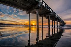 Sunset under the pier (KaushikChowdhury) Tags: california sunset beach golden pier sandiego lajolla hour