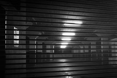 Inside Parking Lot (pillarsoflight) Tags: blackandwhite bw monochrome beauty night oregon 35mm dark portland grate prime lights aperture nikon parkinglot parking lot fluorescent adobe pdx desaturated 18 pillars pnw lightroom d3300