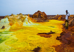 Afar man in front of colorful volcanic landscape in the danakil depression, Afar region, Dallol, Ethiopia (Eric Lafforgue) Tags: africa travel lake man color male tourism nature pool horizontal landscape outdoors spring colorful day desert earth acid horizon surreal formation heat minerals environment sulphur geology ethiopia hotspring volcanic saline geothermal arid oneperson ecosystem hornofafrica afar eastafrica geological abyssinia onlymen fulllenght onemanonly 1people afarregion dallol danakildepression oneadultonly ethio161988