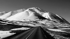 memo from a road back to winter (lunaryuna) Tags: road travel light bw snow mountains ice monochrome weather season landscape blackwhite iceland spring roadtrip journey lunaryuna weathermood seasonalwonders