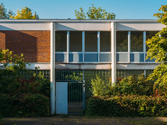 school. (angsthase.) Tags: school autumn light sky green fall glass reflections germany deutschland licht weeds cityscape shadows bricks herbst himmel nrw grn schatten ruhrgebiet dortmund shrubbery 2014 ruhrpott mft micro43 epl5 sigma60mmf28dn