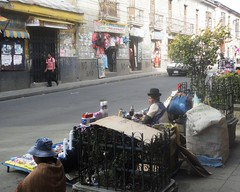 Selling toiletries on the street (virharding) Tags: bolivia bowlerhat lapaz cholita