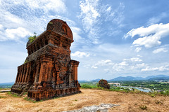 Banh It Tower (trocphunc) Tags: travel blue sky people brick tower abandoned architecture silver asian temple ruins asia skies place faith hill religion towers ruin culture historic vietnam holy hindu desolate exclusive cham champa qui banh nhon thap