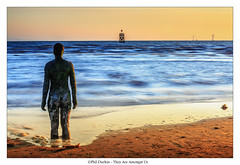 They Are Amongst Us ! (Phil Durkin) Tags: ocean uk travel blue sunset sea england sky sun seascape beach water statue clouds liverpool coast sand place wind farm tide shoreline another antony gormley crosby merseyside