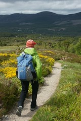 Down to Aviemore (rich_brame) Tags: woman scotland hiking trails backpack raincoat aviemore