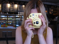 Polarise. (Pagynwb) Tags: camera girls portrait woman coffee girl yellow shop youth hair polaroid photography cafe hands women teens coffeeshop teen starbucks blond cameras portraiture blonde faceless mustard polaroids barista