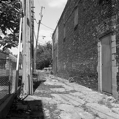 (patrickjoust) Tags: johnstonsquare baltimore maryland rolleiflex28f aristaeduultra400 developedinrodinal150 tlr twin lens reflex 120 6x6 medium format black white bw home develop film blancetnoir blancoynegro schwarzundweiss manual focus analog mechanical patrick joust patrickjoust usa us united states north america estados unidos autaut car auto automobile alley