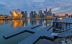 Sunset in Singapore (RomeoJunior) Tags: singapore marinabaysands marinabay sunset architecture city cityscape skyline buildings longexposure travel nikon nightphotography nightimages nightshot