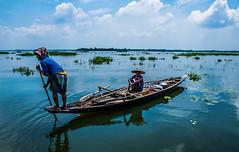Fishing (mithila909) Tags: people lake fisherman boat rural urban lifestyle sky cloud water bangladesh