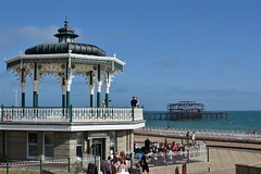 2016-08-12: Kissing On The Bandstand (psyxjaw) Tags: brighton beach august summer friday afternoon holiday sun pier old victorian burnt skeleton remains heritage bandstand band sea seaside water channel