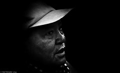 Kobiashi. (Neil. Moralee) Tags: portrait blackandwhite bw white man black art monochrome face hat norway blackbackground contrast scarf dark japanese nikon close profile neil tourist svalbard arctic spooky nono 18200mm d7100 moralee barentsberg neilmoralee svalbardnorwaylongyearbyenneilmoralee
