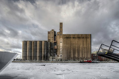 Silo & Ice (Underground Joan Photography) Tags: winter urban toronto heritage abandoned ice landscape industrial silos lakeontario industrialarchitecture canadamaltingcompany discoveron