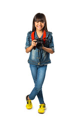 Smiling young asian girl holding photo camera (Patrick Foto ;)) Tags: camera portrait people baby white cute film girl beautiful beauty smile face childhood female studio lens asian fun toy thailand happy person photography one photo kid holding funny pretty photographer technology child hand image little background small joy young picture happiness equipment human photograph thai leisure concept cheerful taking isolated