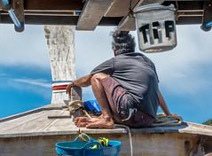 longtail boat sailor (dominiquesainthilaire) Tags: thailand kohpoda aonang krabi sailor longtailboat marin thailandais andaman sea merdandaman travelplanet ngc worldtrekker infinitexposure thisphotorocks greatphotographers aasia awsomeasia
