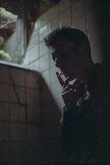 Breathing in this silence Like never before (ArneSchramm) Tags: shadow urban guy mamiya film analog 35mm dark bathroom fuji superia cigarette portait smoke exploring analogue 800 urbex msx1000