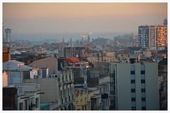 The city of Barcelona (albertpuiggrosvega) Tags: barcelona city sunset sea sky colors birds clouds mar edificios nikon colours rooftops ciudad cel colores cielo nubes contraste puestadesol gaviotas tejados nuvols condal cityofdreams ciudadcondal d7100
