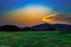 Sunset (Bakhtiar PWR) Tags: blue pakistan sunset summer sky orange sun green nature clouds landscape dawn ray natural islamabad