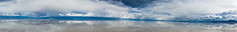 Panorama of Salar de Uyuni (oncearoundtheworld) Tags: park blue wild summer sky panorama white lake reflection southamerica nature water beautiful rock clouds spectacular landscape natural 4x4 outdoor extreme wide salt lakes scenic bolivia panoramic clear national production remote shallow rough exploration salar impressive magnificent altiplano resources uyuni recreational