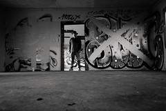 without appropriate papers or permissions (Super G) Tags: blackandwhite bw selfportrait man abandoned standing graffiti room ground x doorway scs permissions nikon231