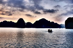 Gulf of Tonkin (Melvin Yue) Tags: street city travel sunset sea water colors 35mm boat asia vietnamese ship cityscape colours gulf streetphotography vessel wanderlust traveller vietnam explore limestone fujifilm lonelyplanet bluehour karst hdr goldenhour halongbay photooftheday picoftheday natgeo travelphotography travelgram x100s
