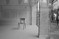 Empty chair ... Cadair wag, Pontypridd, south Wales (Dai Lygad) Tags: windows urban bw white black shop geotagged photography grey one town photo blackwhite flickr downtown alone sad image artistic noiretblanc empty creative photograph silla simplicity creativecommons shopwindow stark psychogeography emptyseat emptiness exposed chaise pontypridd vide stockphoto flaneur vaco cadair stockimage emptychair gwag attributionlicense freetouse byitself attributionlicence cadairwag