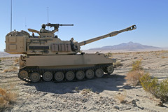 FORT IRWIN, Calif. - U.S. Army Sgt. Eric Holtso assigned to Alpha Battery, 3rd Battalion, 29th Field Artillery Regiment, 3rd Armored Brigade Combat Team, 4th Infantry Division, maneuvers an M109A6 Paladin for defensive tactical operations during Decisive (Operations Group, National Training Center) Tags: california ca camera usa training army us desert soldiers troops tanker mohave videography fortirwin nationaltrainingcenter 3rdbattalion 4thinfantrydivision m109a6paladin alphabattery 3rdbrigade ashleymarble opsgroup combatphotographers vultureteam spcmarble 29thfieldartilleryregiment engagingenemies decisiveactionrotation1502