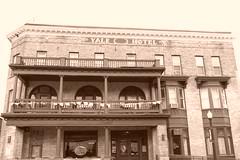Small Town Slumber Spot (BMillerRoth) Tags: old windows building brick glass sepia hotel inn michigan balcony porch yale tone