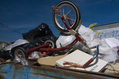 tricycle in the garbage (Nashville Street Photography) Tags: red nashville tricycle streetphotography trike ricoh eggleston nashvilletn nashvilletennessee ricohgrd ricohimages ricohgrdcolor ricohcolor egglestonstricycle