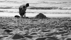 Budding builder (criatvt) Tags: building construction beach chennai india street bw monochrome blackandwhite sand thiruvanmiyur