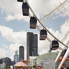 Untitled (Kyle Pozan) Tags: city sky chicago mamiya film skyline clouds skyscraper lakemichigan ferriswheel navypier trumptower ektar mamiya7 shootfilm ektar100 centennialwheel