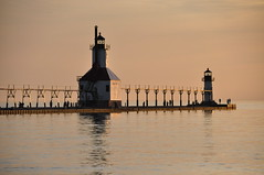 in the golden hour (christiaan_25) Tags: blue summer sky orange lighthouse lake reflection beach nature water colors yellow clouds landscape outside outdoors gold evening waves glow outdoor pov michigan horizon perspective stjoseph lakemichigan shore lakeshore catwalk tiscorniapark stjosephlighthouse