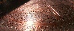 (Akilene ) Tags: red macro reflection warm pattern copper something sunbeam chaleur cuivre