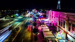 Downtown Gilbert (Techjunkie00) Tags: street pink blue signs tower heritage cars water speed lights nice neon lolos district nighttime pomo gilbert zinburger