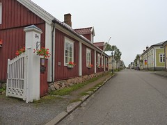 Some of the wooden houses of old town Kokkola, Finland (KaarinaT) Tags: kokkola old town oldtownkokkola woodenhouses finland houses oldtown rowofhouses colorful quaint