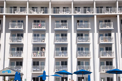 (gwoolston) Tags: motel blue white jerseyshore capemay seaside pool umbrella balconies