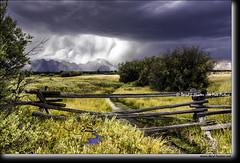 Buckrail Fence,  Thunderstorm (Daryl L. Hunter - Hole Picture Photo Safaris) Tags: grandtetonnationalpark daryllhunter grandtetons jacksonhole storm wyoming unitedstates usa buckrailfence western sky stream blacksky rain